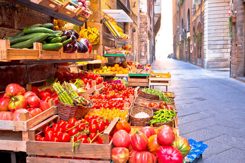 Fruit and vegetable market in narrow Florence street, Tuscany region of Ital