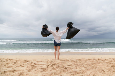 Woman on Beach After Trash Cleanup