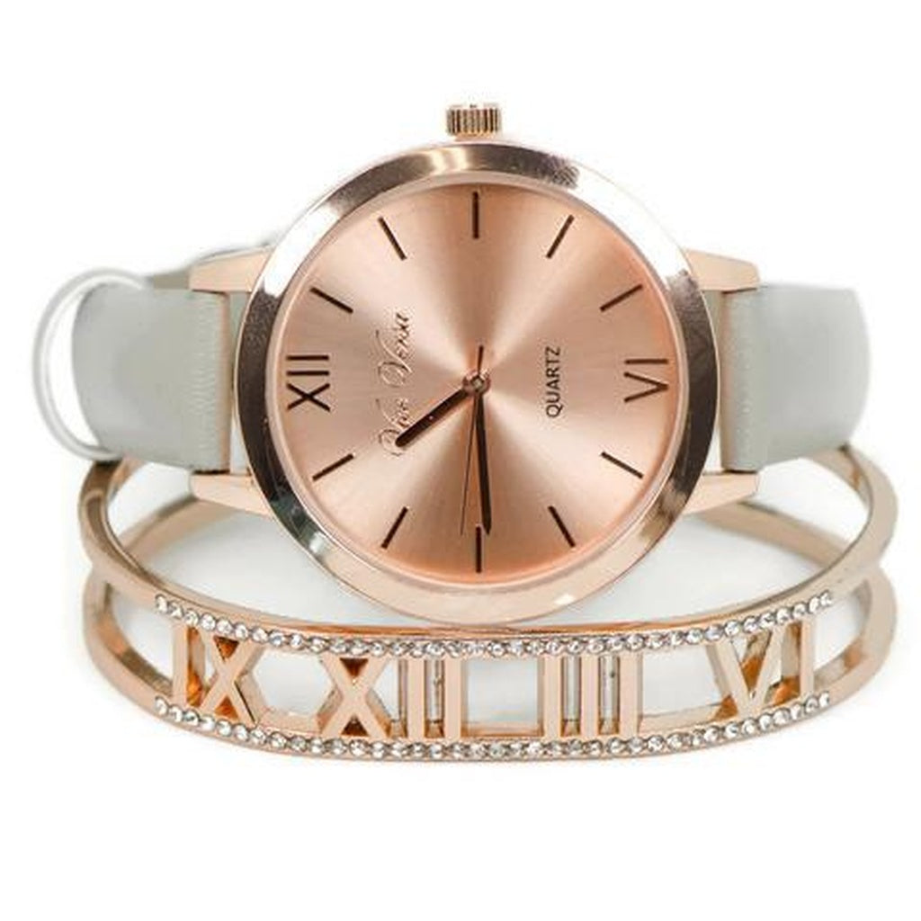 Beautiful rose watch and matching bracelet with roman numerals.