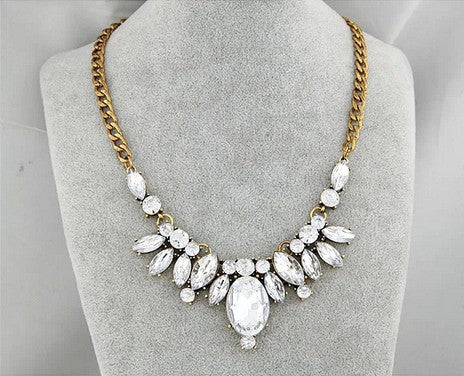 Beautiful white plant, gold plated necklace.
