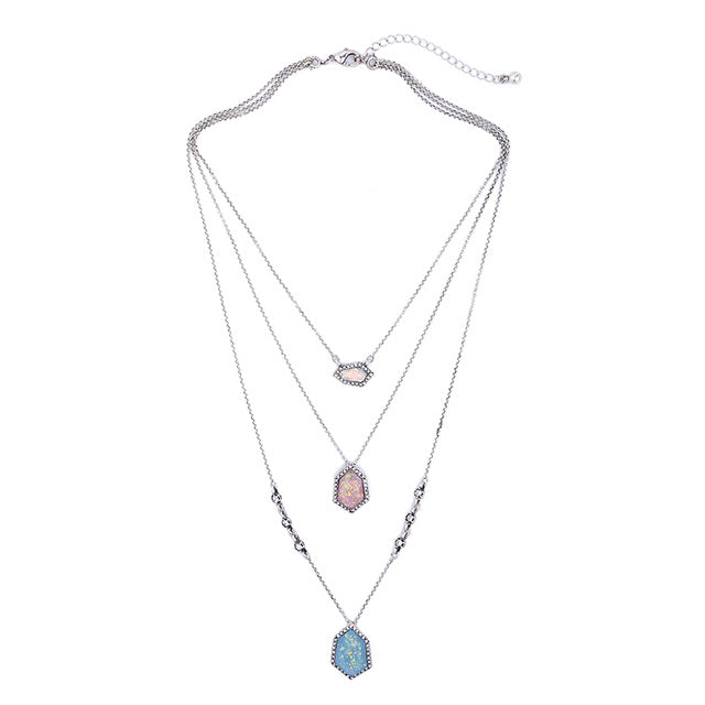 A delicate multilayered necklace with colored rhinestones.