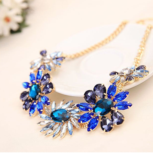 A beautiful rhinestone flower necklace in blues.