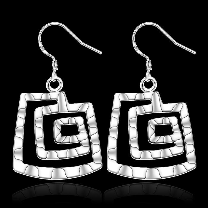 Striking abstract silver earrings.