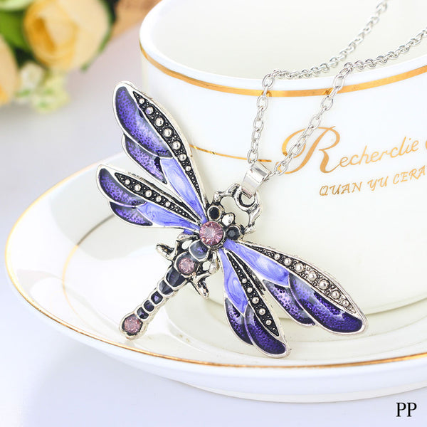 Lovely dragonfly pendants in four colors.