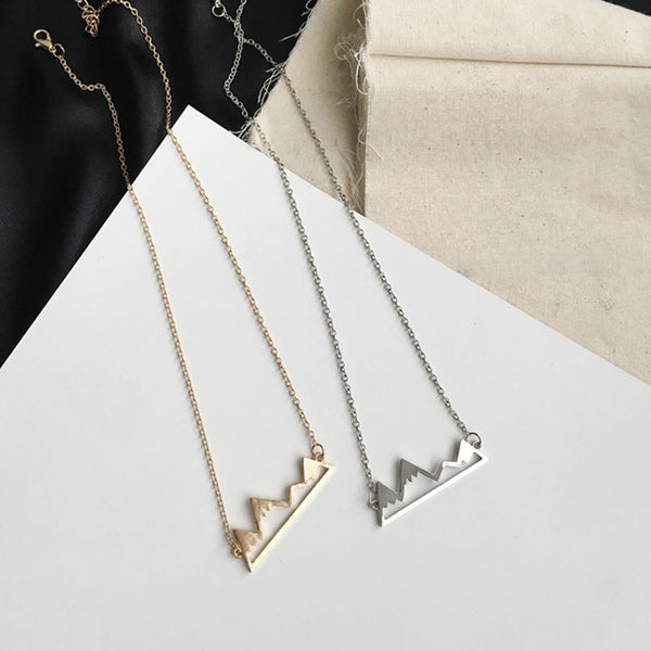 mountain top necklaces in either gold or silver.