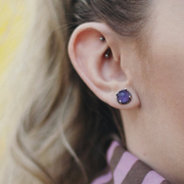Round stud earrings in faceted amethyst stone