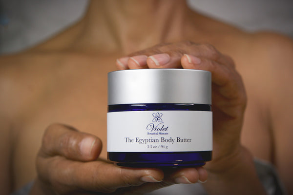 Hands holding Violet Botanical Skincare The Egyptian Body Butter