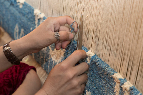 A rug being manufactured by hand