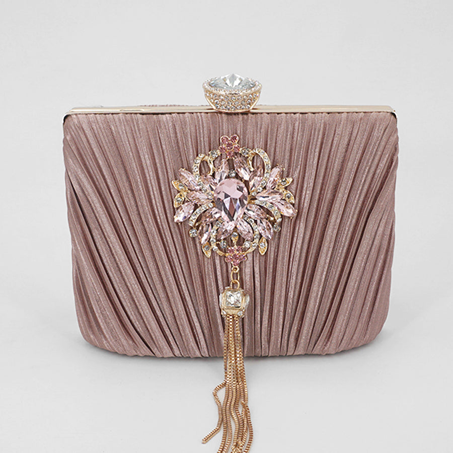 bejeweled tassel clutch