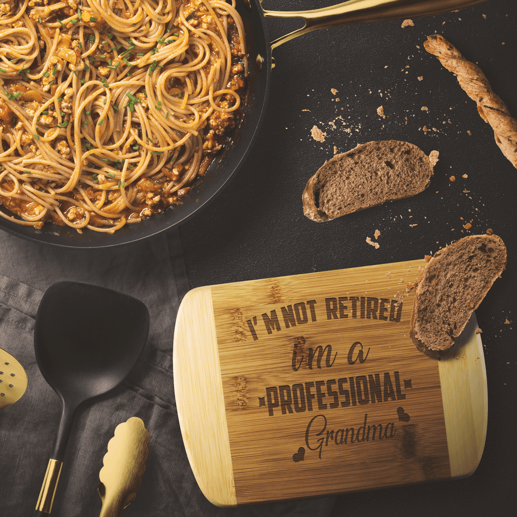 """I'M NOT RETIRED, I'M A PROFESSIONAL GRANDMA""(Special For Kitchen 50% Off) Cutting Borad"