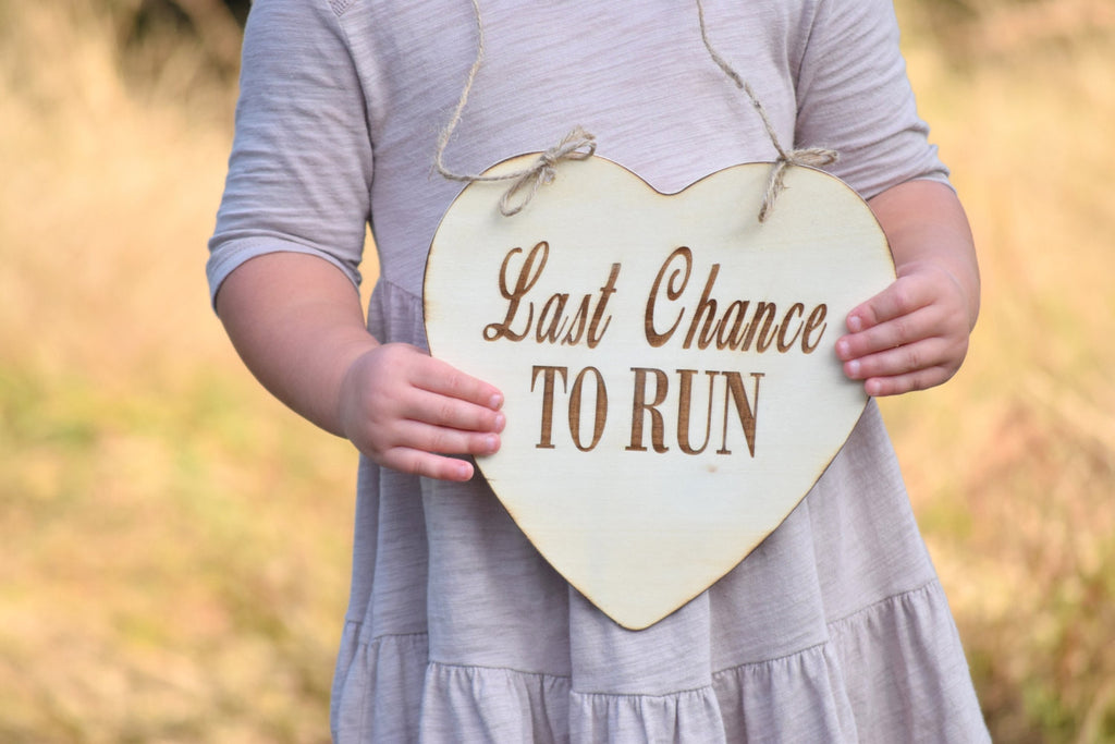 Hanging Last Chance to Run Sign