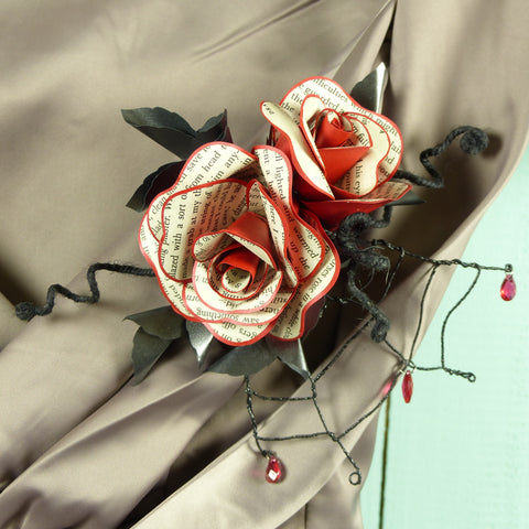 Book page rose corsage in red & black