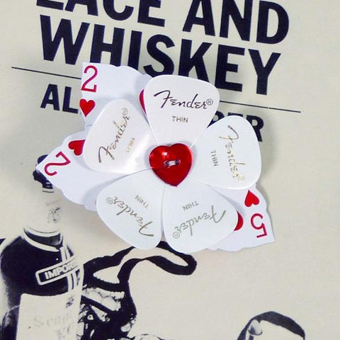 sheet music flower guitar pick buttonhole