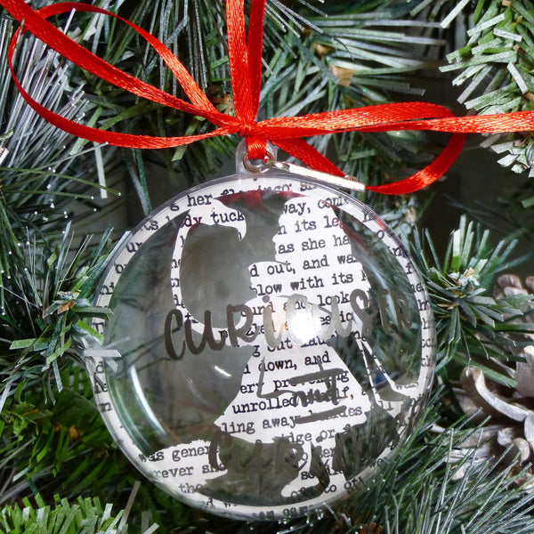 Alice in wonderland paper cut bauble text reads curiouser & curiouser