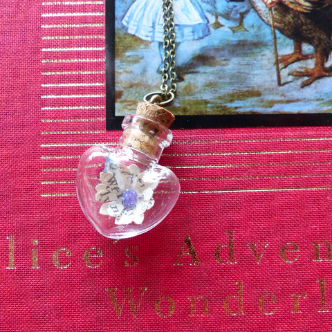 Alice in wonderland heart necklace
