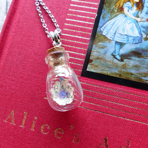 Alice in Wonderland daisy in bulb bottle necklace