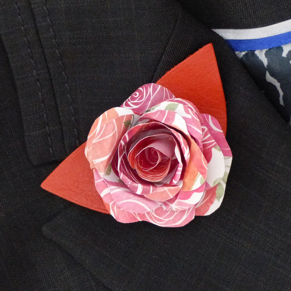 pink and orange paper rose buttonhole