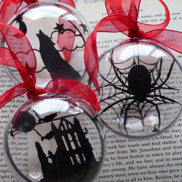 Dracula bauble set paper cut silhouettes from Whitby Abbey, Howling wolf & spider