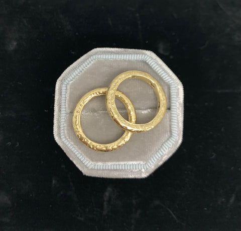 Two matched 14ct gold hammered bands