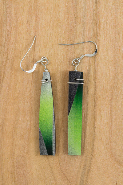RideWear's Kaleidoscope Series #023 is a unique Earrings jewelry accessory handmade from carbon fiber bicycle frames with 14k gold or sterling silver accents.