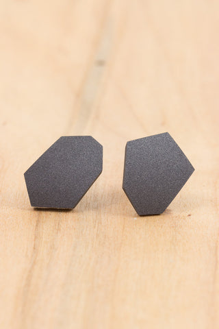 RideWear's Gray Fox Series #003s is a unique Stud Earrings jewelry accessory handmade from carbon fiber bicycle frames with 14k gold or sterling silver accents.