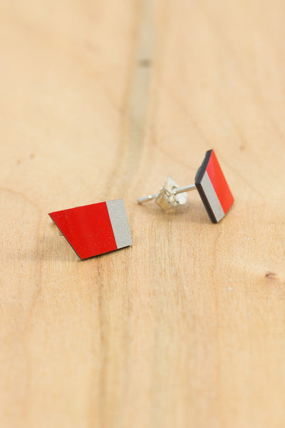 RideWear's Ruby Series #007s is a unique Stud Earrings jewelry accessory handmade from carbon fiber bicycle frames with 14k gold or sterling silver accents.