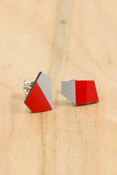 RideWear's Ruby Series #006s is a unique Stud Earrings jewelry accessory handmade from carbon fiber bicycle frames with 14k gold or sterling silver accents.