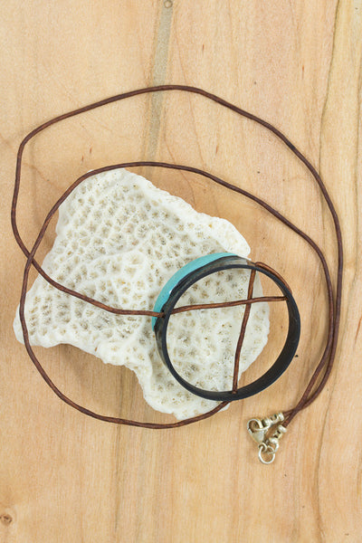 RideWear's SeaFoam Series #003N is a unique Necklace jewelry accessory handmade from carbon fiber bicycle frames with 14k gold or sterling silver accents.