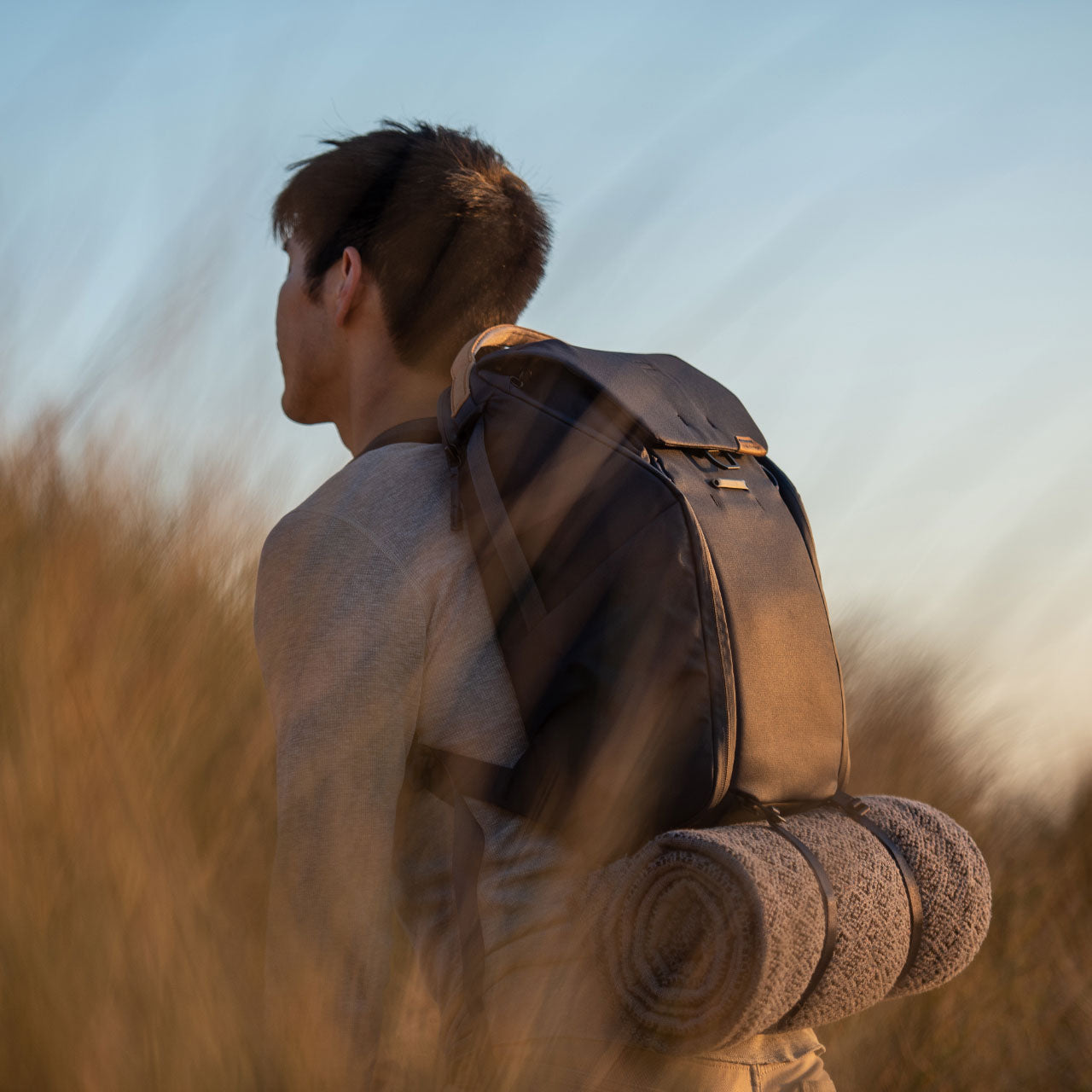 Man with Everyday Packpack in field