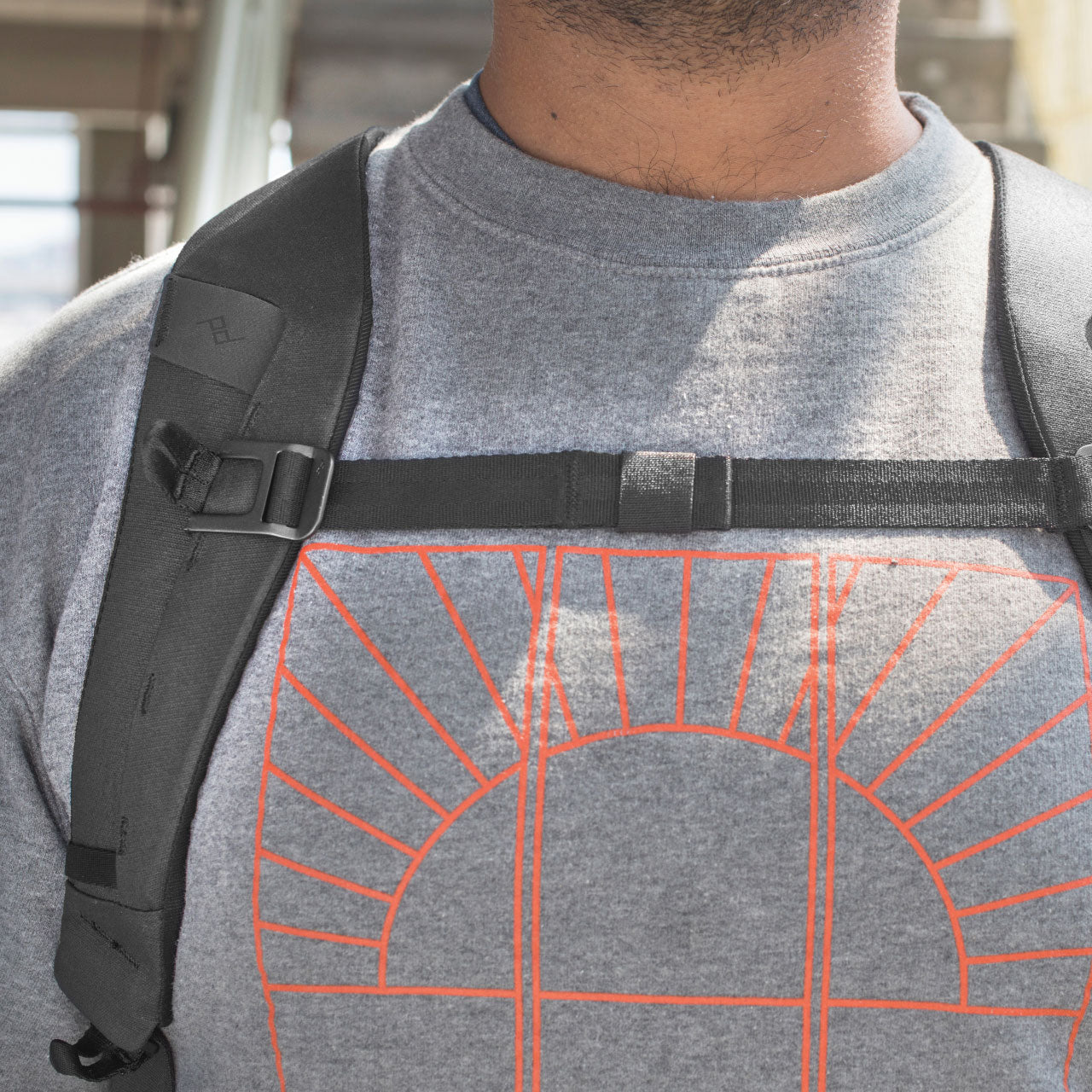 Man removing laptop from Everyday Backpack