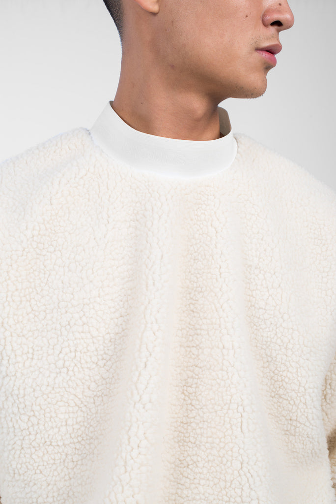 Ivoiry shearling turtle neck sweater