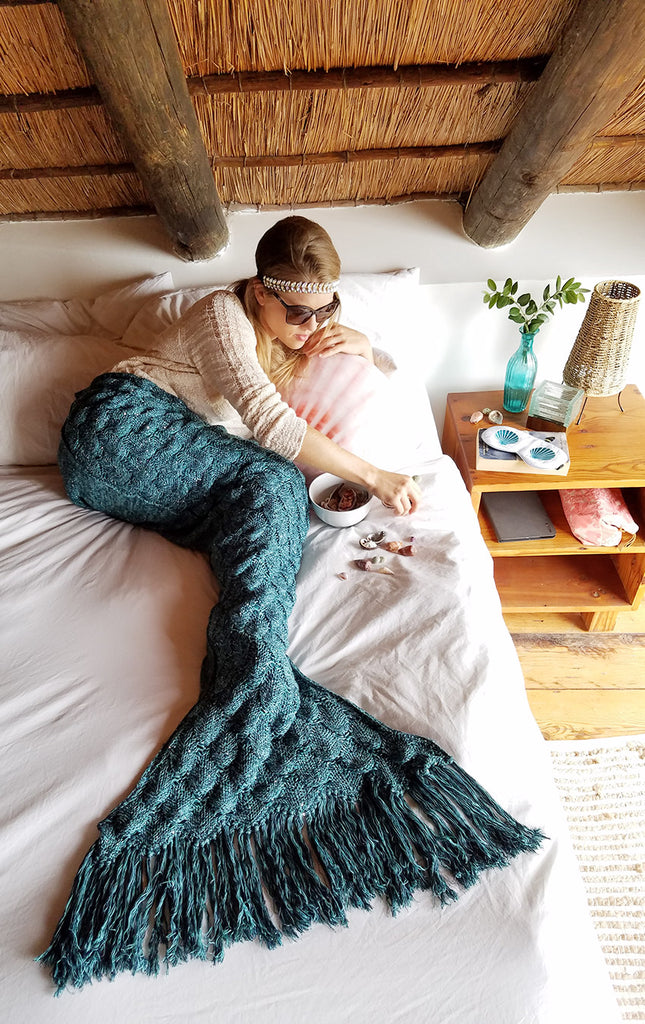 Sorting shells in a Mermaid Tail Blanket