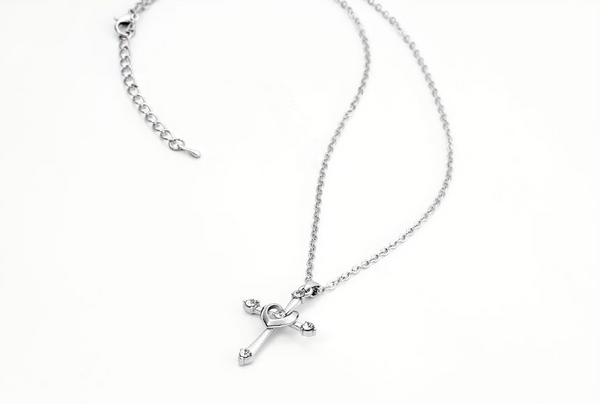 Brilliant Crystal Accent Cross with Heart Pendant