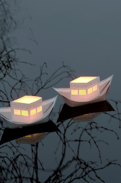 Folding paper lightboats by Jurianne Matter from Radiance