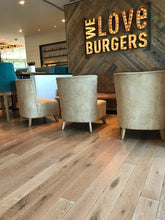 White wide plank wood flooring