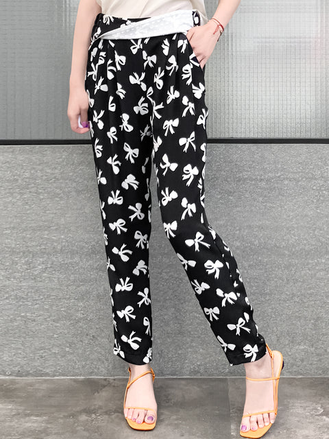 Black Bow Print Contrast Twist Waist Taper Trousers