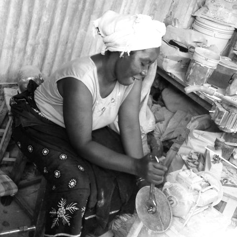 ladies at work... artisans making handmade jewelry that are pieces of African art