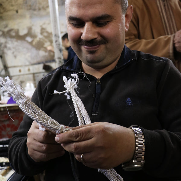 Youssef, the master artisan who makes our sunglass straps, unique design handmade in Africa