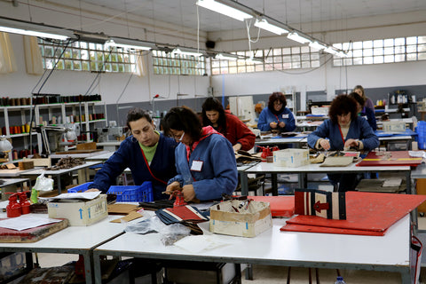 Ladies at work at the Faitrade Mateus manufacture, working on our handmade shoulder bag and leather wallet.