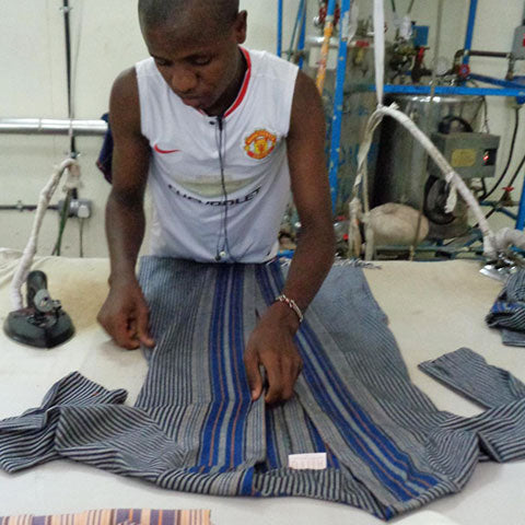 Working on our blue and black African style striped hippie shirt.
