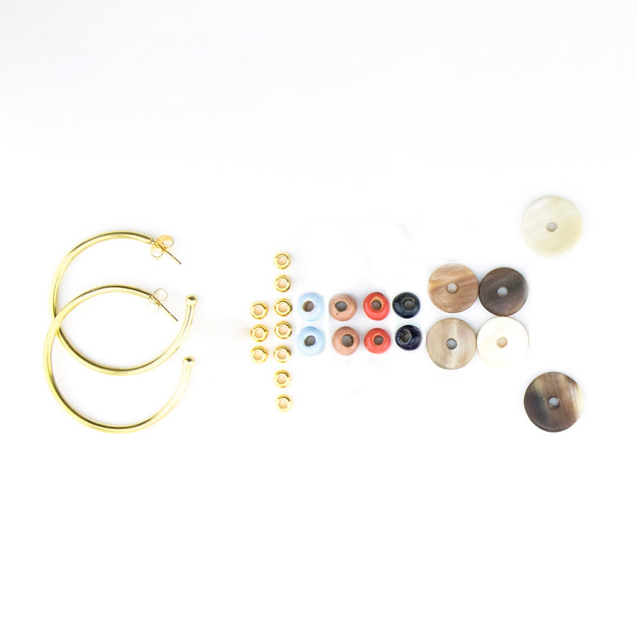 Gold hoop earrings with beads in coral, blue, midnight and beige - African jewelry handmade in Kenya.
