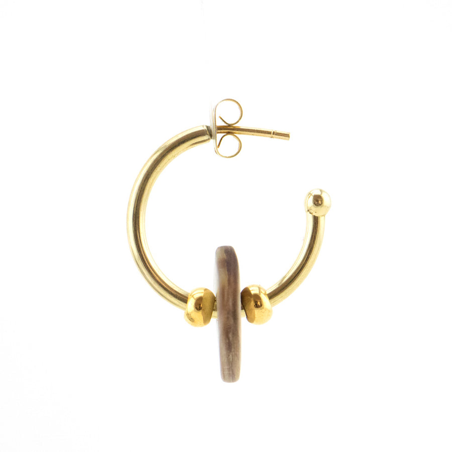 Small golden earrings for a hippie look- a real piece of African art