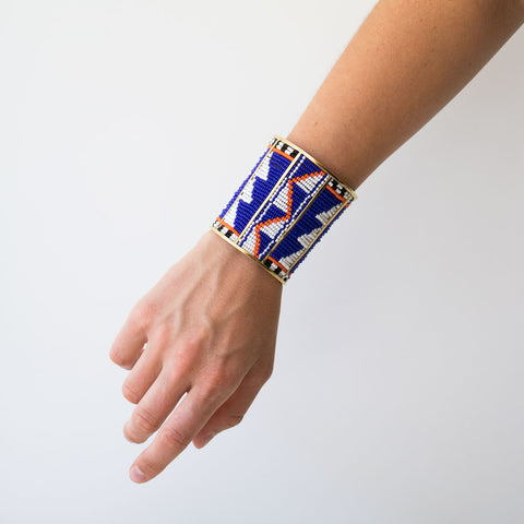 African style cuff Maasai bracelet - arm bracelet with glass beads in orange, blue, black and white.
