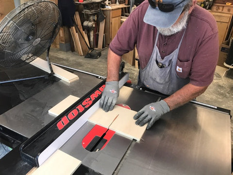 cutting out a coinhole board on a table saw