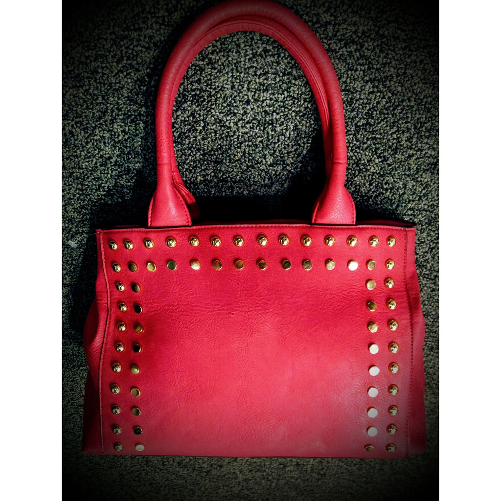 Beautiful pink colored handbag with side embellishments -.