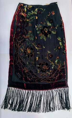 Beautiful and unique  skirt velvet feel with fringe on the bottom size small - medium