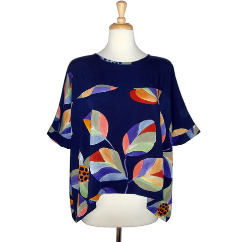 beautiful and fun floral print blouse with large colourful flowers in blue, purple, red, green, and yellow.