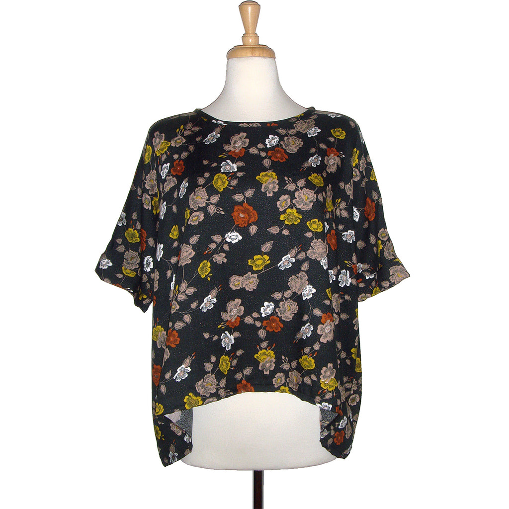 loose fitting top in a beautiful floral print on a dark background filled with yellows and rusty reds