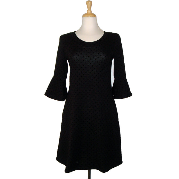 sweater dress in black on black polka dots with 3/4 length peplum sleeve with pockets