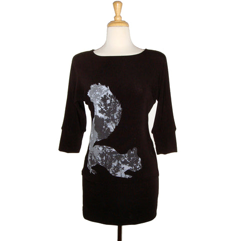 soft black knit tunic sweater dress with squirrel screen print. Squirrel silhouette is formed with a background of trees.